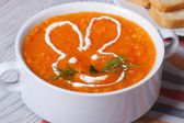 Cream soup of carrots for children with bunny close-up — Stock Photo
