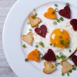 Romantic breakfast of fried hearts of vegetables and eggs — Stock Photo #47781501