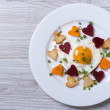 Fried potatoes, carrots, beets and egg of heart on a plate. — Stock Photo #47781515