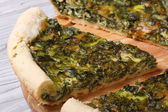 Tasty and healthy vegetable pie with spinach macro — Stock Photo
