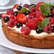 Delicious berry tart with strawberries, raspberries, mint — Stok fotoğraf #48146199