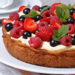 Delicious berry tart with strawberries, raspberries, mint — Stock fotografie #48146199