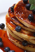 Blueberry pancakes drenched  syrup. Macro top view — Stock Photo