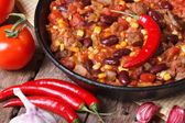 Chili con carne close-up in a pan with the ingredients.  — Stock Photo