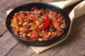 Mexican food is chili con carne in a frying pan  — Stock fotografie