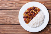 Chili con carne and rice on a white plate top view — Foto de Stock