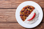 Chili con carne and rice village background horizontal — Stock Photo