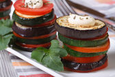 Eggplant, zucchini and tomatoes on a plate — Stock Photo