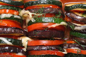 Background of eggplant, zucchini and tomatoes baked — Stock Photo