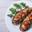 Stuffed aubergine with meat, cheese and tomatoes — Stock Photo #48845729