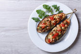 Half baked eggplants with meat, cheese and tomatoes — Stock Photo