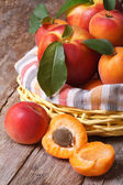 Apricot halves closeup on background baskets of fruit — Stock Photo
