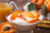 Apricot yoghurt and fresh juice closeup horizontal — Stock Photo