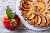 Fruit tart and fresh peach closeup top view — Stock Photo