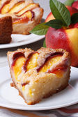 Slice of peach pie on a white plate vertical  — Stock Photo