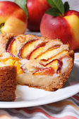 Cut peach pie on the background of fresh fruit  — Stockfoto