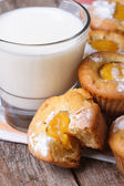Peach muffins with milk close-up on the table. vertical  — Stock Photo