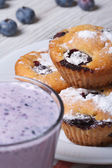 Blueberry muffins on a white plate and berry cocktail vertical  — Stock Photo