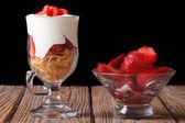 Yogurt with strawberries and cornflakes horizontal. low key — Stock Photo