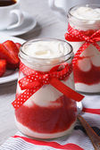 Strawberry yogurt in a jar on the table vertical — Stock Photo