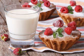 Fresh cupcakes with raspberries closeup and milk horizontal  — Stock Photo