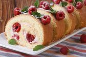 Swiss roll with raspberry and mint close up horizontal — Stock Photo
