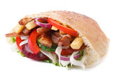 Doner with meat, vegetables and fries in pita isolated on white — Stock Photo