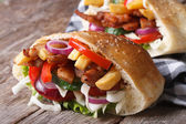 Two doner kebab with meat, vegetables and fries in pita bread — Stockfoto