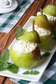 Fresh pears stuffed with cottage cheese vertical — Stock Photo