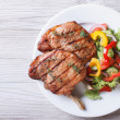 Pork meat grilled with fresh vegetable salad top view — Stock Photo #51425503