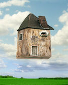 Flying house — Stock Photo