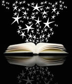 Open book and bright stars — Stock Photo