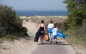Family walking to the beach — Stock Photo