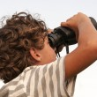 Stock Photo: Young boy with binoculars
