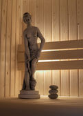 Concrete statute in sauna — Stock Photo