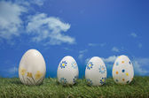 Easter eggs with blue sky — Stock Photo