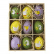 Wooden box with eater eggs — Stock Photo