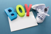 Baby boy card with text and shoes — Stock Photo
