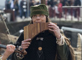 Woman playing panflute — Stock Photo