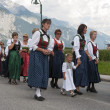 Female and girls walking i traditional dresses in austria proces - Stok fotoğraf