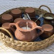 Braided basket with tea set — Stock Photo