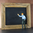 Stock Photo: Business person against the blackboard