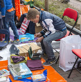 Boy counting his earned money on queensday market — Stock Photo