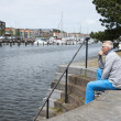 Man sitting and thinking near the water — Stock Photo