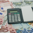 Euro money paper and calculator — Stock Photo