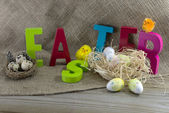 Easter with letters and jute background — Stock Photo