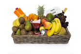 Fruit basket with wine drink orange banan and others — Stock Photo