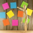 Wooden wall with post it papers — Stock Photo #45964023