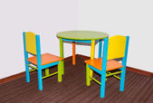 Two small school chairs and table — Stock Photo