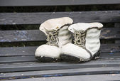 Decoration of high shoes on bench — Stock Photo